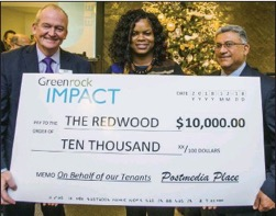 Justin Taylor, Greenrock Real Estate Advisors, and Alaric da Cunha, right, Postmedia Place, present a $10,000 donation cheque to Natasha Hoyte