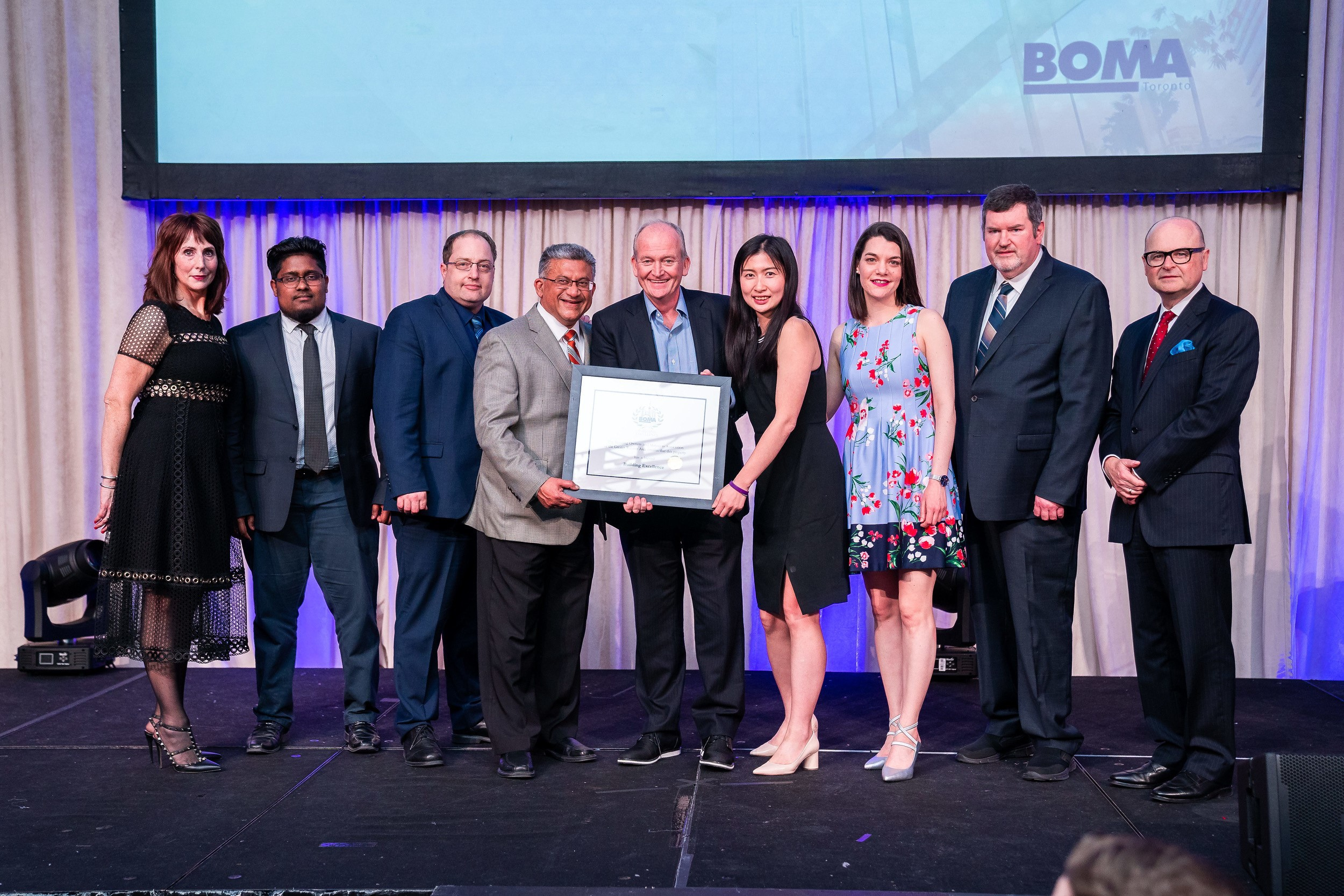 Postmedia Place Management Team Accepting BOMA Award